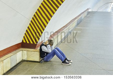 little boy crying in the subway station negative emotion