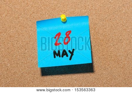 May 28th. Day 28 of month, calendar on cork notice board, business background. Spring time, empty space for text.