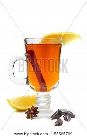 mulled wine in a glass of Irish with lemon cinnamon cumin decorated with chocolate