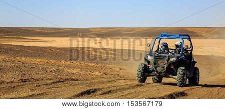 Merzouga, Morocco - Feb 25, 2016: Panoramic View Of Blue Polaris Rzr 800 And Pilots In Morocco Deser