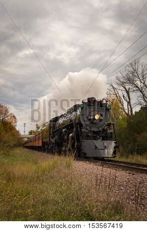 CHANHASSEN MN - OCTOBER 8 2016: The Milwaukee Road #261 steam train on its annual Fall Colors Tour from Minneapolis MN to Glencoe MN. This line has not had regular passenger trains traffic since 1960.