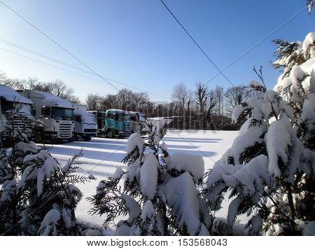 A parking of trucks full of snow