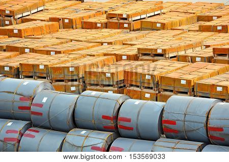 Stacked rusty rolled metal ready for shipment in port