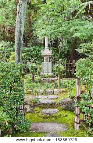 UJI JAPAN - JULY 27 2016: Grave of samurai Minamoto Yorimasa on grounds of Byodo-in Temple in Uji city near Kyoto. Yorimasa (1106-1180) committed suicide at Byodo-in after defeat in Battle of Uji
