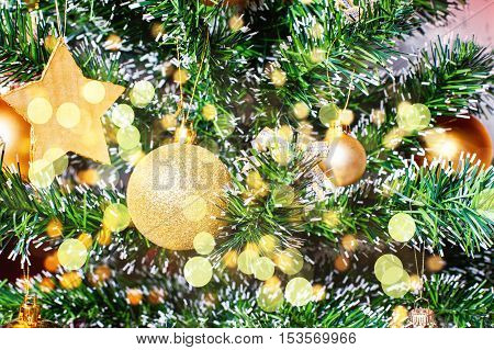 Christmas Golden Ornaments On Tree Closeup