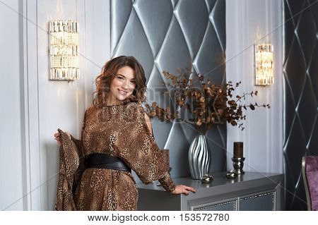 beautiful happy woman posing in the interior.