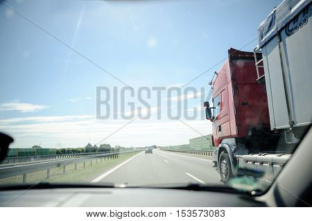 Traffic On The Freeway With Cars And Trucks Overtaking