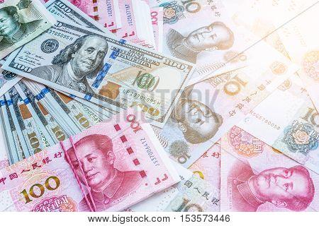 China and USA money bank notes and sunlight.