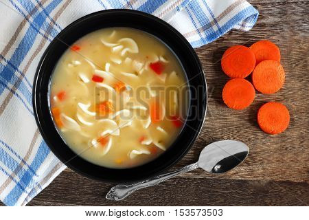 Traditional Chicken Noodle Soup, Overhead Scene On A Rustic Wood Background
