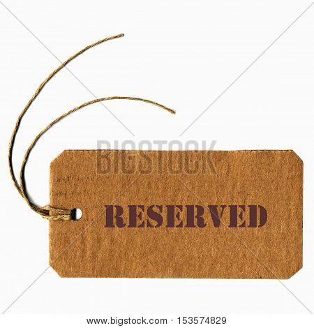 reserved price tag label with string over white background