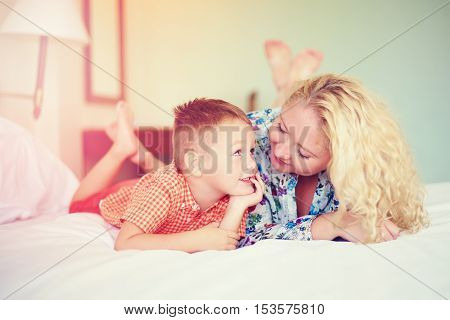 happy mother and son talking at home
