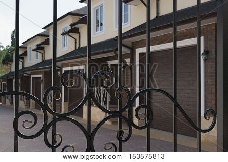 new townhouses behind the bars of iron gate