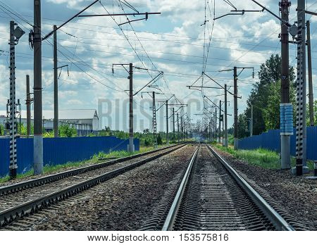 Railroad tracks stretching into the distance concept