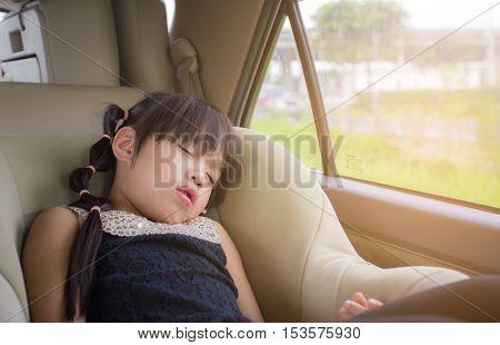 little girl sleeping in child car seat