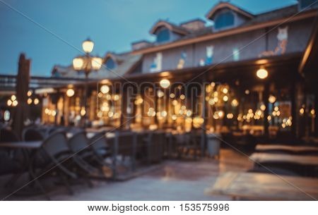 blurred  Image restaurant in dark background .