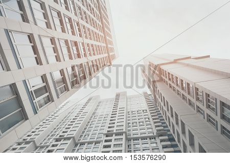 Contemporary white and grey residential skyscraper apartment building in Moscow on a bright day two housing body view from bottom