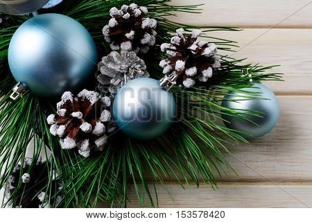 Christmas background with blue ornaments and decorated pine cones. Christmas party decoration.