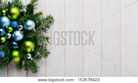 Christmas background with green and blue ornaments. Christmas party decoration. Christmas greeting background. Copy space.