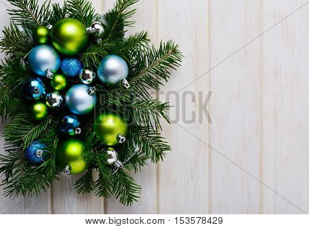 Christmas background with green blue and silver ornaments. Christmas party decoration. Christmas greeting background. Copy space.
