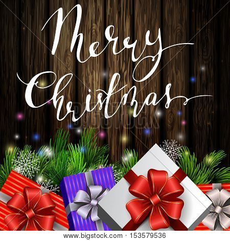 Holiday Christmas background with gift boxes and christmas tree brunches on wooden background and with handwritten Merry Christmas. Vector.