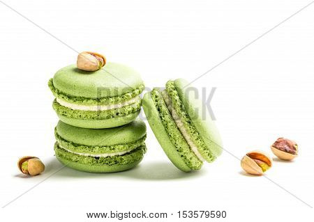 Sweet Macaroons With Pistachio On White Background
