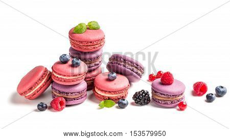 Tasty Macaroons With Fruits On White Background