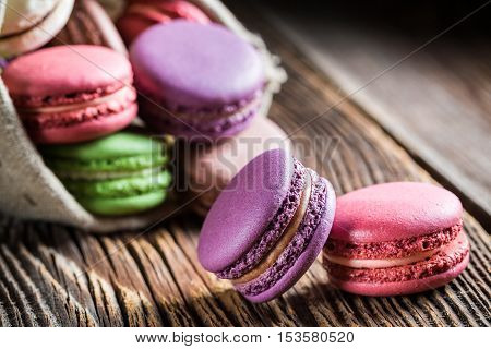 Closeup of sweet macaroons on wooden table