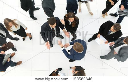 Elevated view of large group of multiethnic business people talk
