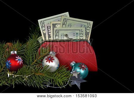 Christmas ornaments and money in red purse on black