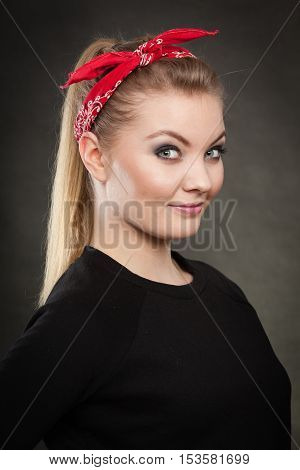 Retro and vintage style. Old fashion. Portrait of lovely pretty young woman in pin up hairstyle with red handkerchief on head.
