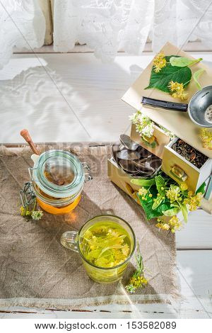 Healthy linden tea with honey in sunny day