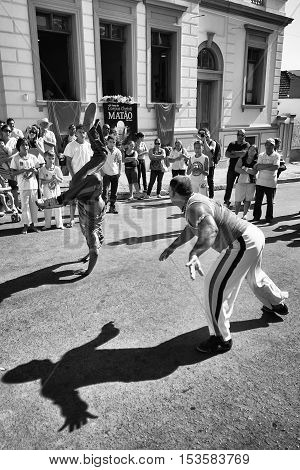 Matão SP Brazil - June 23 2011. Black and white photo of two persons playing capoeira on the street