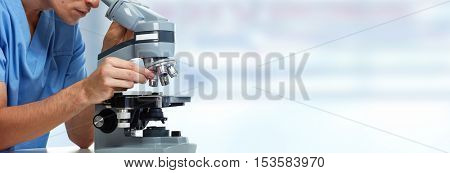 Doctor man with microscope.