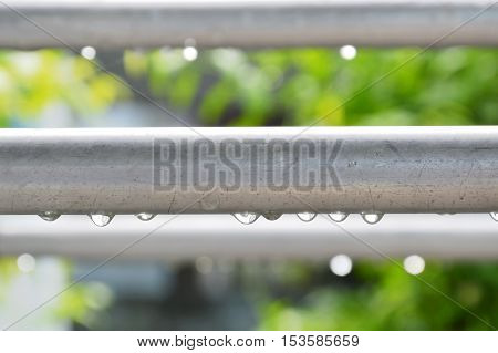 drop of water on aluminum clothes line after raining