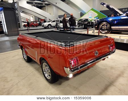 People Admire A Ford Mustang Turned Into A Pool Table