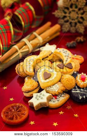 Christmas cookies with festive decoration on red background vertical compositon