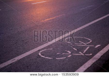 Bike lane asphalt texture , soft focus ,blurred lights