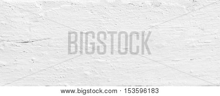 Background of weathered painted white wooden plank