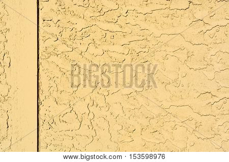 Yellow mortar wall texture with wooden border
