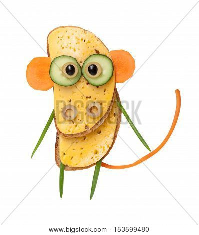 Funny monkey made of bread and vegetables on white background