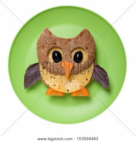 Owl made of bread and cheese on plate