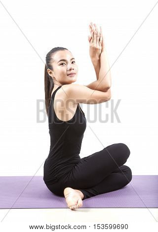 asian woman playing yoga exercise isolate white background
