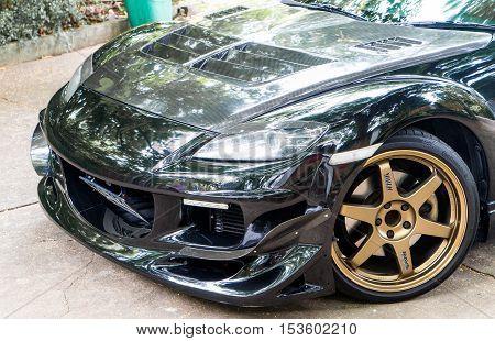 Bangkok, Thailand - September 4, 2016: A Mazda RX8 is wearing Volk Rays TE37 Golden 18 inches Rim.