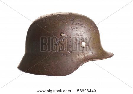 German rusty army helmet  second world war isolated on a white background with cliping path