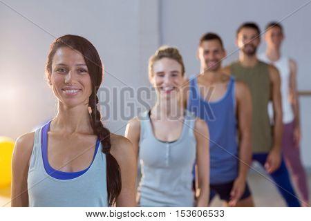Portrait of group of fitness team posing in fitness studio