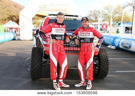 Giniel De Villiers And Navigator, Dirk Von Zitzewitz In Front Of The New Toyota Hilux Evo 2