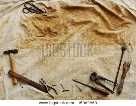 Vintage tool background, on grunge textile background