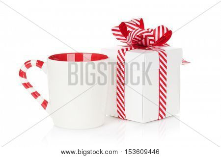 Christmas gift box and mulled wine cup. Isolated on white background