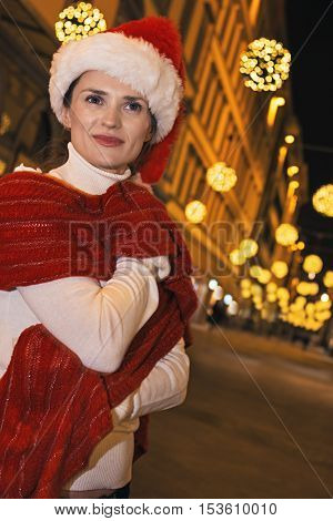 Woman At Christmas In Florence, Italy Looking Into Distance