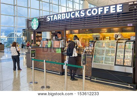 HONG KONG - 06 MAY, 2015: Starbucks coffee shop in Hong Kong Airport. Starbucks Corporation is an American coffee company and coffeehouse chain.
